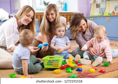 Group of mothers with babies toddlers at playgroup