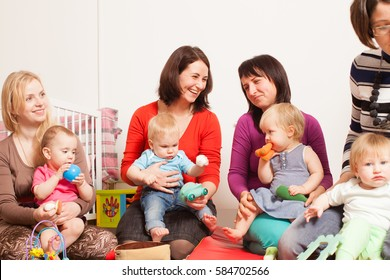 Group of mothers with their babies