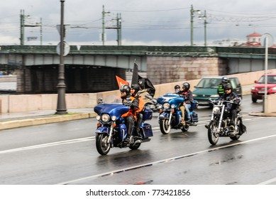 A group of motocycles with flags. St. Petersburg, Russia - 5 August, 2017. The annual Harley-Davidson Festival is held in the center of St. Petersburg.