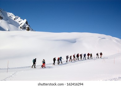 group mountaineers in snow mountains