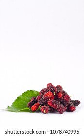 group of mulberries with aleaves on white background healthy mulberry fruit food isolated