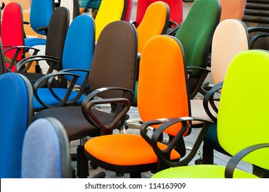 group of multi colored office chairs