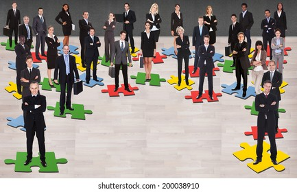 Group of multi ethnic business people standing on jigsaw pieces