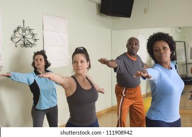 Group of multi ethnic people practicing yoga