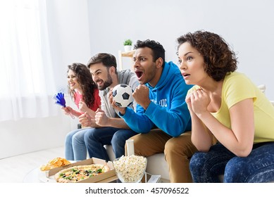 Group of multi national football fans cheerin