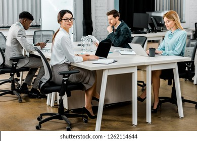 group of multicultural business colleagues working in office