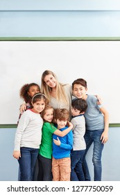 Group of multicultural children and teacher as friends in a primary school