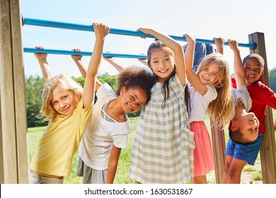 Group of multicultural kids on a sports equipment or playground