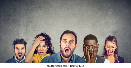 Group of multicultural people being emotional with different feelings and emotions, standing in a row. Women and men expressing anger, desperation, shock