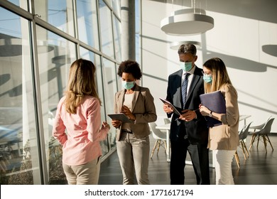 Group of multiethnic business people have a meeting and working in the office while wear mask as protection from corona virus