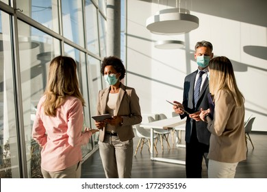 Group of multi-ethnic business people have a meeting and working in the office while wear masks as protection from corona virus