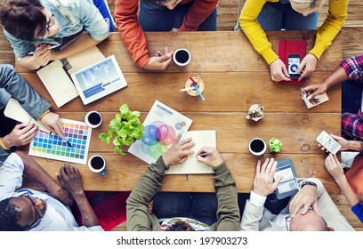Group of Multiethnic Designers Brainstorming - Shutterstock ID 197903273