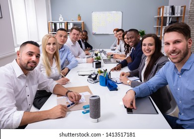 Group Of Multiethnic Diverse Busy Business People Sitting Together At Table In The Office