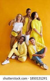 group of multiethnic friends, people of different cultures isolated on yellow background, good-looking men and women in stylish wear posing, students in one country