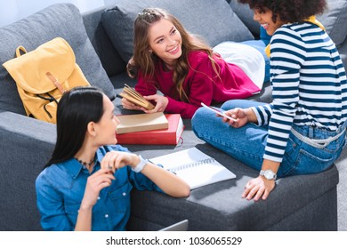 group of multiethnic students doing homework together