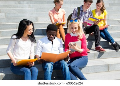 Group of multi-ethnic students prepare for the exam together