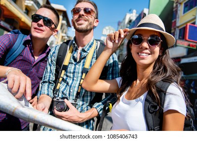 Group of multiethnic tourist backpacker friends traveling in Khao San road Bangkok Thailand on summer holidays