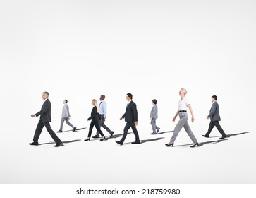 Group of multi-ethnical business people walking in a white background.