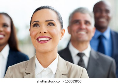 group of multiracial business people looking up
