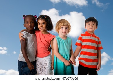 Group of multiracial kids portrait on blue sky background