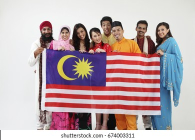 Group of multiracial men and women holding Malaysia flag