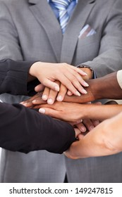 Group Of Multiracial People Stacking Hands Over Each Other