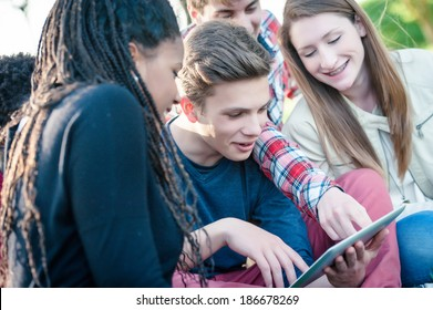 Group of Multiracial Teenage Friends with Tablet PC  - stock