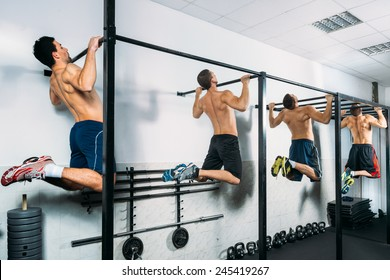 Group of Muscular Men Doing Pull Ups as part of Crossfit Training