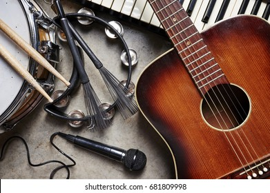 a group of musical instruments including a guitar, drum, keyboard, tambourine. - Shutterstock ID 681809998