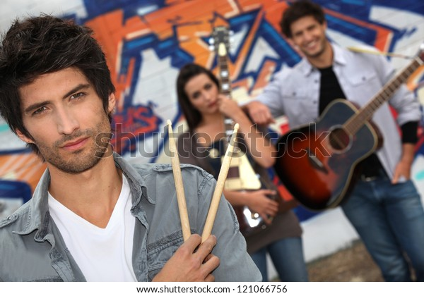 A group of musicians busking on the streets