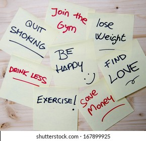 Group of New year Resolutions written on Post it Notes