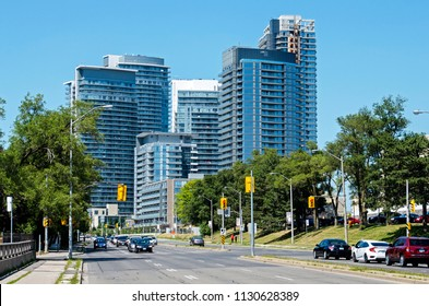 A group of newly-built condominiums along Don Mills Road in North York, Toronto, Ontario, Canada. The suburbs are growing in population and density.