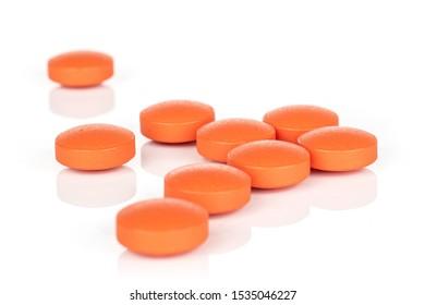 Group of nine whole orange tablet pharmacy isolated on white background