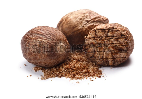 Group of nutmegs (seeds of Myristica fragrans), whole and ground. Clipping paths, shadow separated