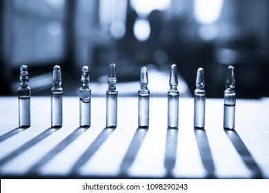 Group object of liquid medicinal agent in limpid glassware in medical laboratory. Ampoules with cosmetical tools, collagen or vitamins