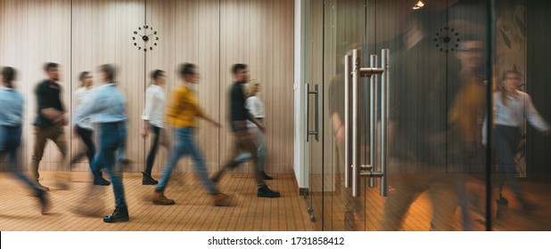 Group of office people walking at office open space. Team of business employees at coworking center. People at motion blur. Concept working at action