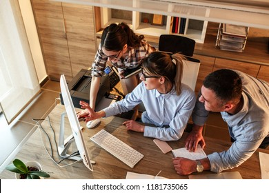 Group of office workers using computer and discuss about business project.Teamwork concept.