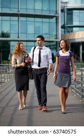 Group of office workers walk outdoor