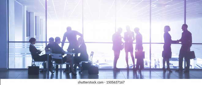 Group ofl  silhouettes of businesspeople comunications  background business centre