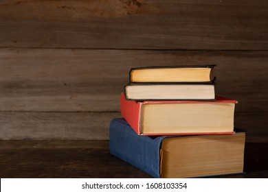 Group of old books on the wooden table, Education and reading concept.