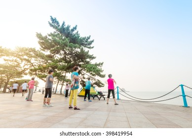 Group of old people dancing for exercise