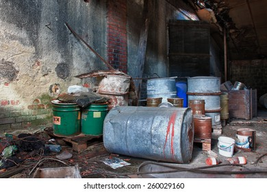 Group of old, rusty barrels with toxic chemical  waste. Photo was taken on place, where textile factory was wrong  demolished.