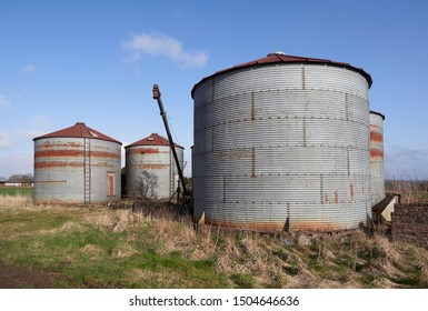 A group of Old and unused 1940's style Corrugated metal Silo's beside a rural minor road near Gardyne, Letham in Angus Scotland.