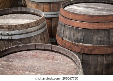 Group of old wooden barrels, selective focus on a foreground
