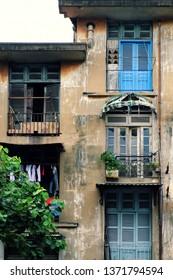 Group of old wooden window and antique door at facade of old house at Ho Chi Minh city, Vietnam