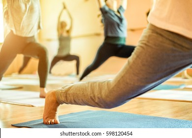 Group of old and young women doing yoga in Vipassana meditation school - Spiritual concept for healthy and relax lifestyle - Focus on female bottom foot - Warm contrast filter