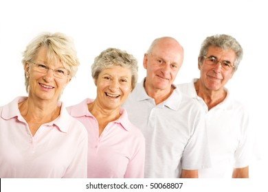 Group of older mature people having fun and smiling in the gym