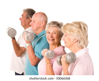 Group of older mature people lifting weights in the gym