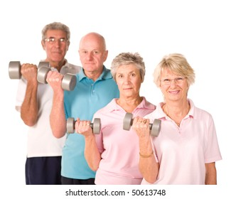 Group of older senior people lifting weights in the gym