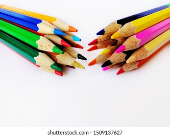 group of colored pencil on white background, selective focus
